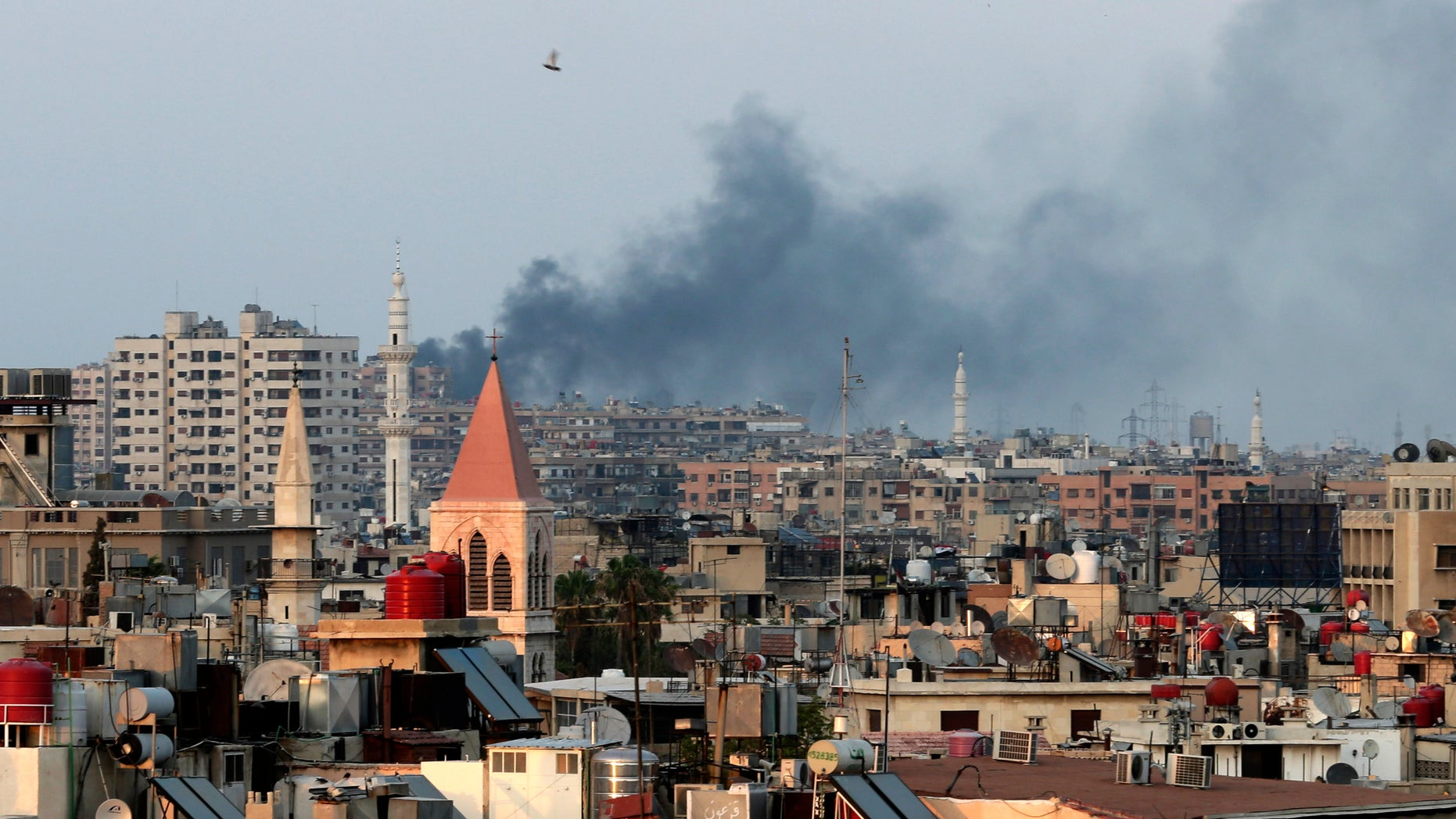 Aug. 22, 2013: Columns of smoke rising from heavy shelling in the Jobar neighborhood in west Damascus, in Cairo, Syria.