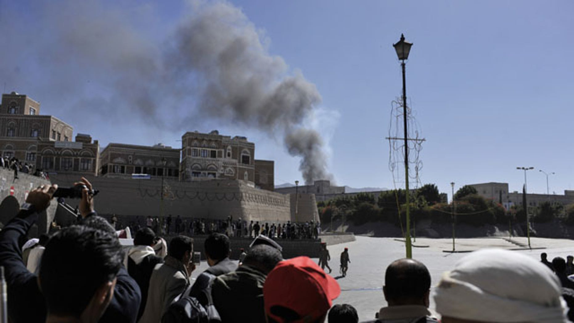 December 5, 2013: Smoke rises after an explosion at the Defense Ministry complex in Sanaa, Yemen. (AP Photo/Mohammed Hamoud)