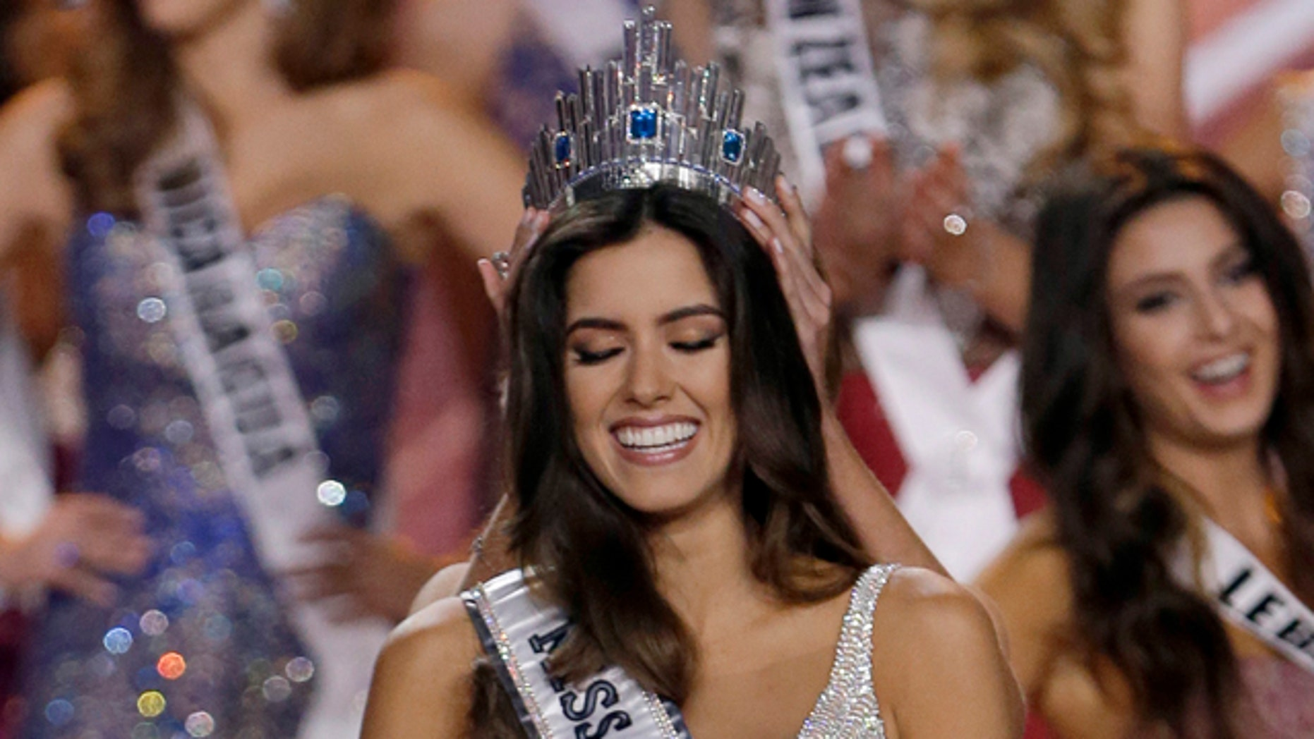 Jan. 25, 2015: Miss Colombia Paulina Vega smiles as the the crown is placed on her head as she becomes Miss Universe during the Miss Universe pageant in Miami. (AP Photo/Wilfredo Lee)