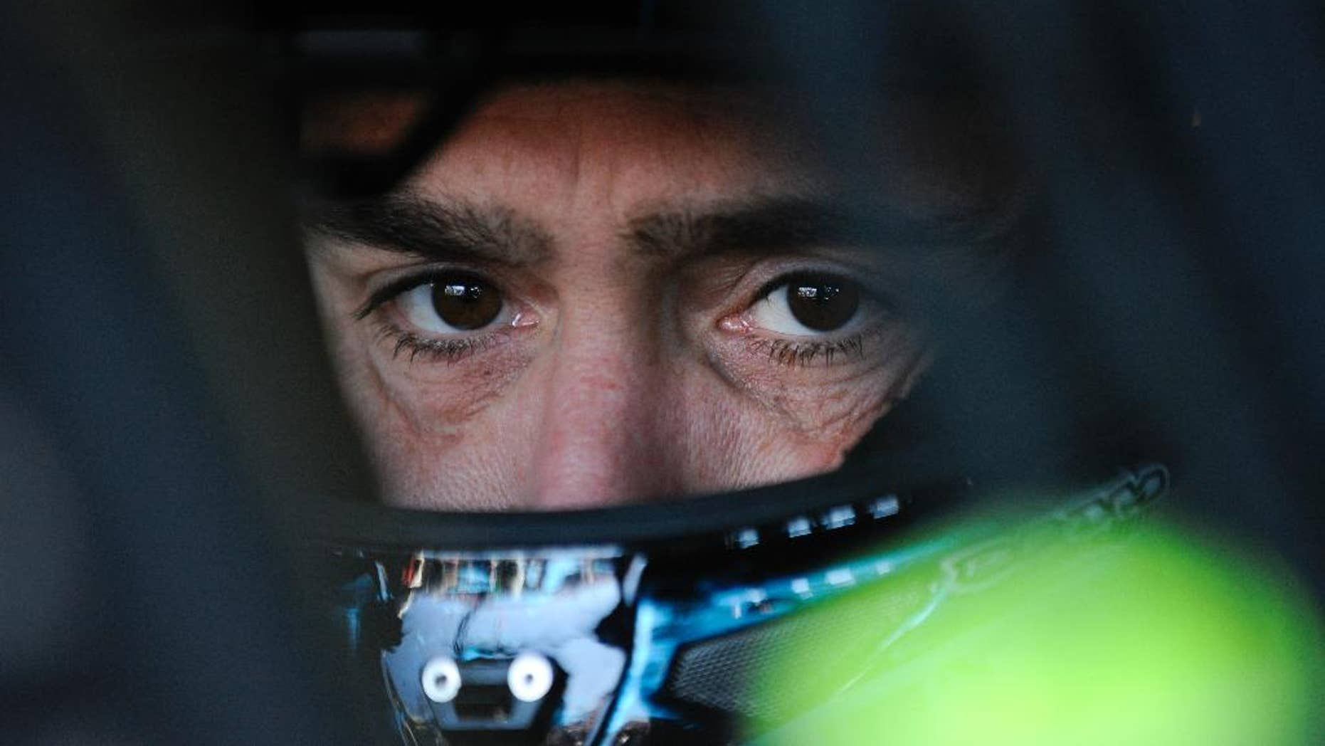 NASCAR driver Jimmie Johnson sits in his car as he waits to practice for Sunday's NASCAR Sprint Cup Series auto race at Talladega Superspeedway Friday, Oct. 17, 2014, in Talladega, Ala.  Johnson has one shot to keep his bid for a record-tying seventh championship going. The defending NASCAR champion must win at Talladega to avoid elimination from the Chase. (AP Photo/Rainier Ehrhardt)