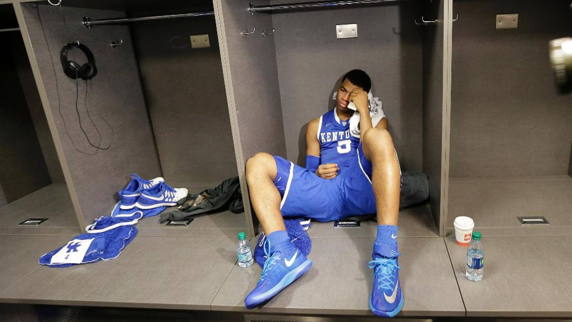 Kentucky guard Andrew Harrison sits in the locker room after his team's 60-54 loss to Connecticut in the NCAA Final Four tournament college basketball championship game Monday, April 7, 2014, in Arlington, Texas. (AP Photo/Eric Gay)