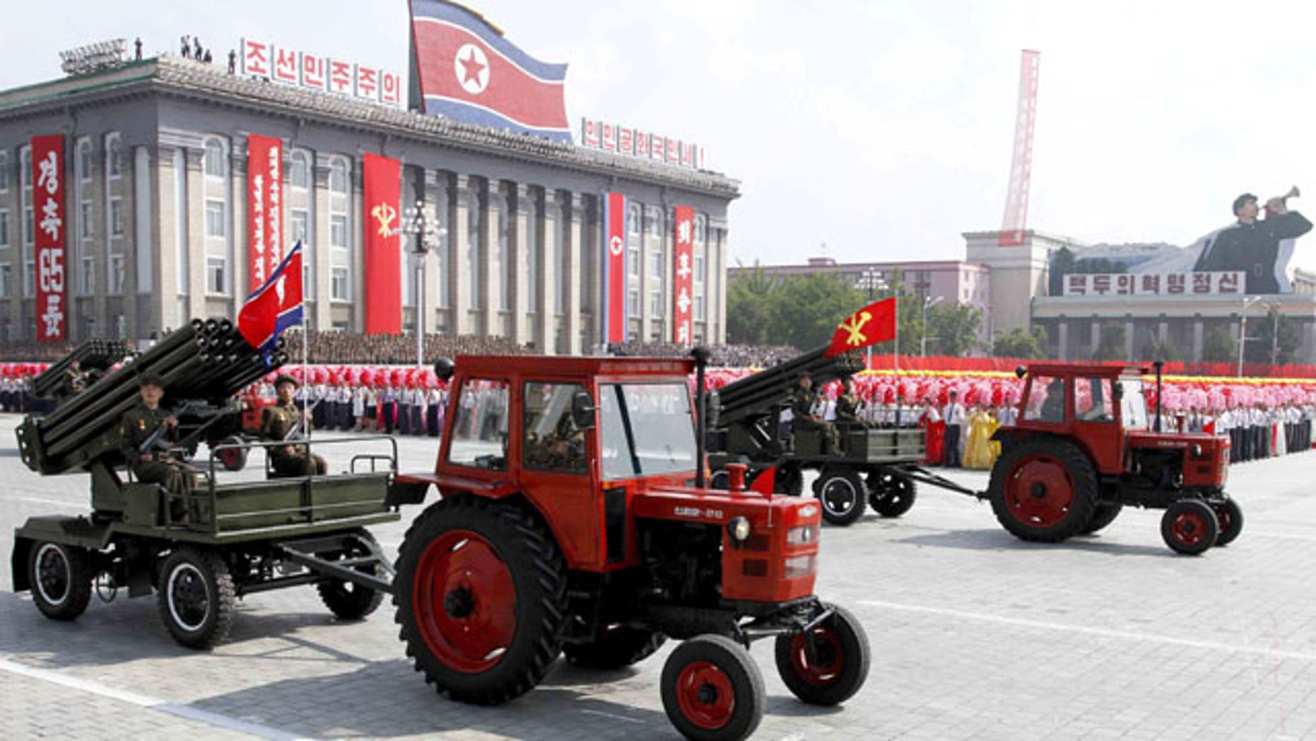 September 9, 2013: Tractors pull artillery through Kim Il Sung Square during a military parade to mark the 65th anniversary of North Korea's founding in Pyongyang.