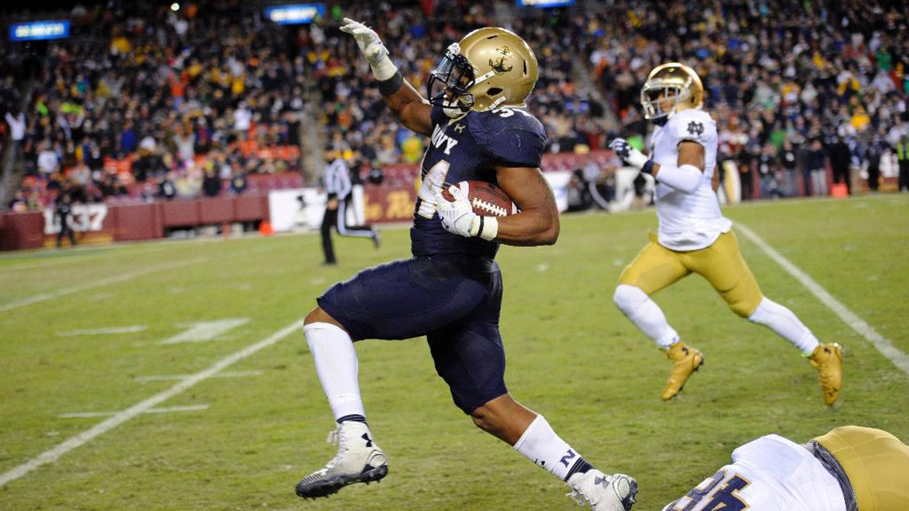 Navy fullback Noah Copeland, left, runs away from Notre Dame linebacker Greer Martini (48) during the second half of an NCAA college football game, Saturday, Nov. 1, 2014, in Landover, Md. Notre Dame won 49-39. (AP Photo/Nick Wass)