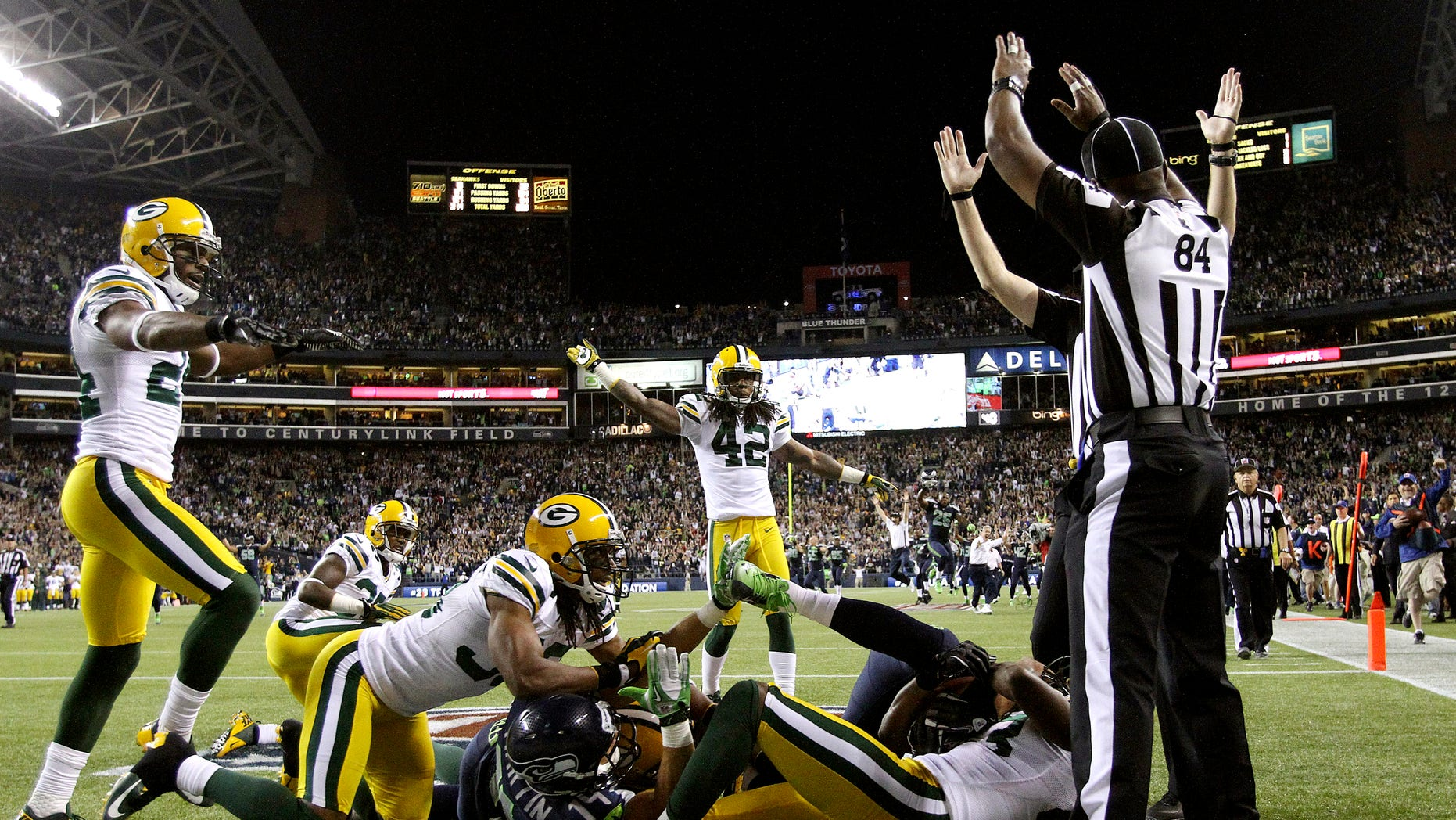 Sept. 24, 2012: Officials signal a touchdown after Seattle Seahawks wide receiver Golden Tate pulled in a last-second pass from quarterback Russell Wilson to defeat the Green Bay Packers 14-12 in an NFL football game.