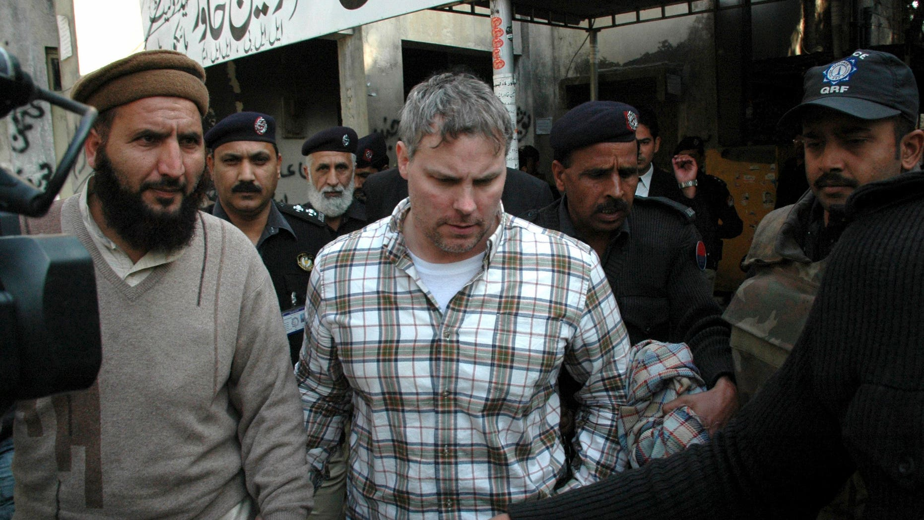 Jan. 28, 2011: Pakistani security officials escort Raymond Allen Davis, center, to a local court in Lahore, Pakistan. The Associated Press has learned that Davis, an American jailed in Pakistan after the fatal shooting of two armed men, was secretly working for the CIA.