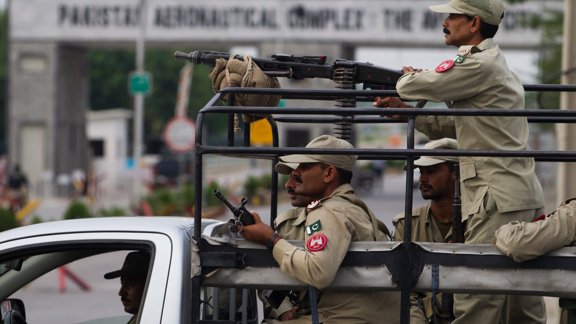 Aug. 16, 2012: Pakistani security personnel guard the main entrance of Pakistan air force base in Kamra, about 50 miles (85 kilometers) northwest of Islamabad, Pakistan.