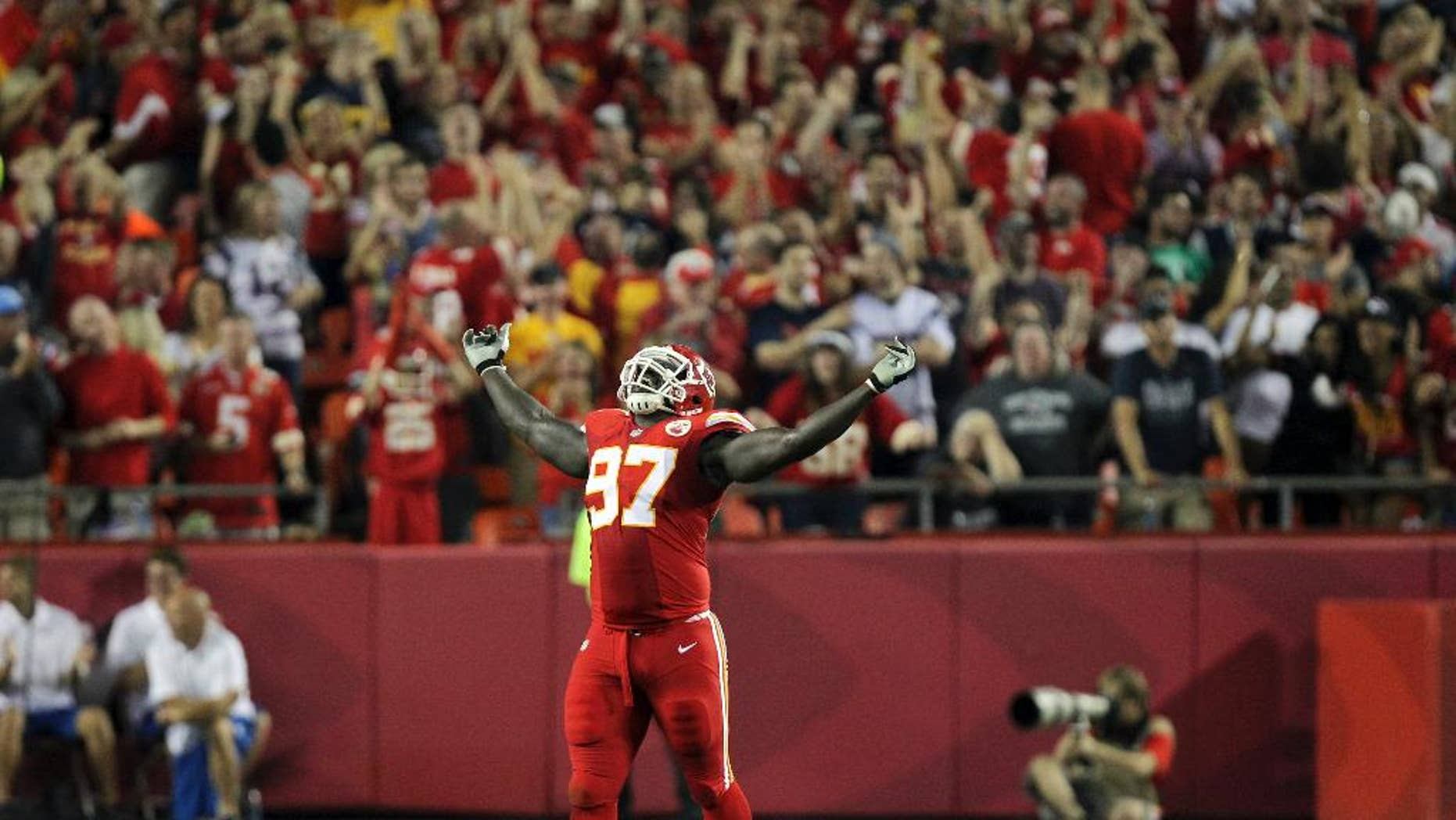 Kansas City Chiefs defensive end Allen Bailey celebrates after teammate Sean Smith intercepted a pass and ran it back 34-yards during the third quarter of an NFL football game against the New England Patriots, Monday, Sept. 29, 2014, in Kansas City, Mo. (AP Photo/Ed Zurga)
