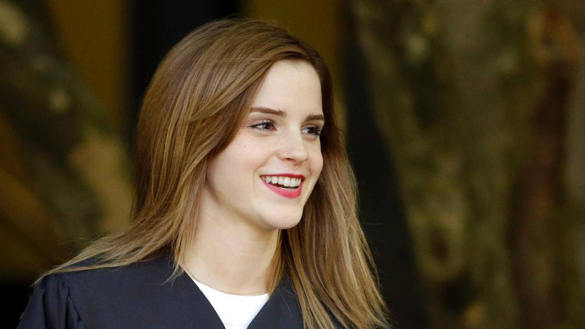 """Actress Emma Watson walks between buildings following commencement services on the campus of Brown University, Sunday, May 25, 2014, in Providence, R.I. The actress, best known for her role as Hermione Granger in the """"Harry Potter"""" movies, graduated with a bachelor's degree in English literature from the Ivy League university. (AP Photo/Steven Senne)"""