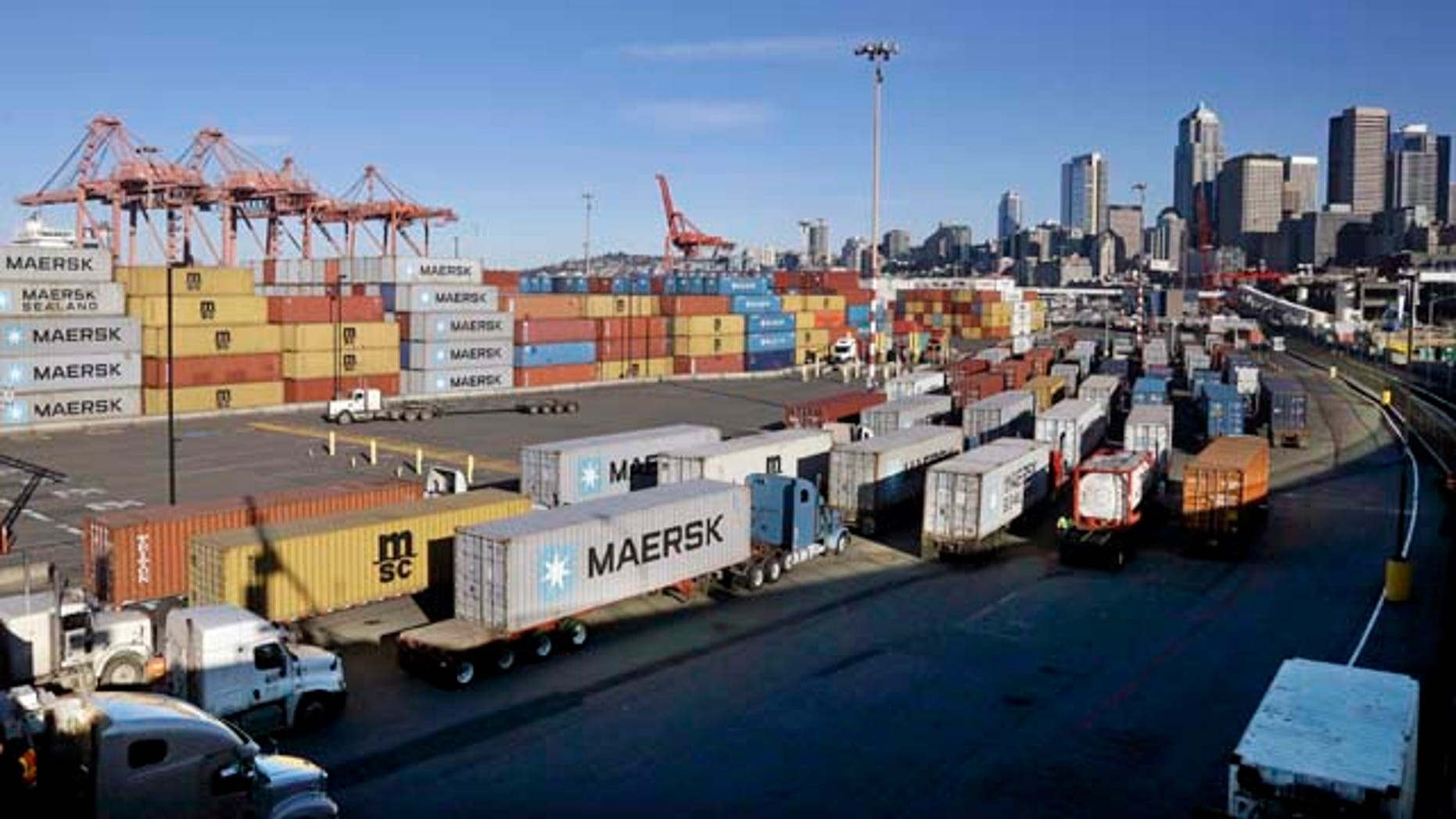 Feb. 17, 2015: Loaded container trucks line-up at a gate at the Port of Seattle. (AP Photo/Elaine Thompson)