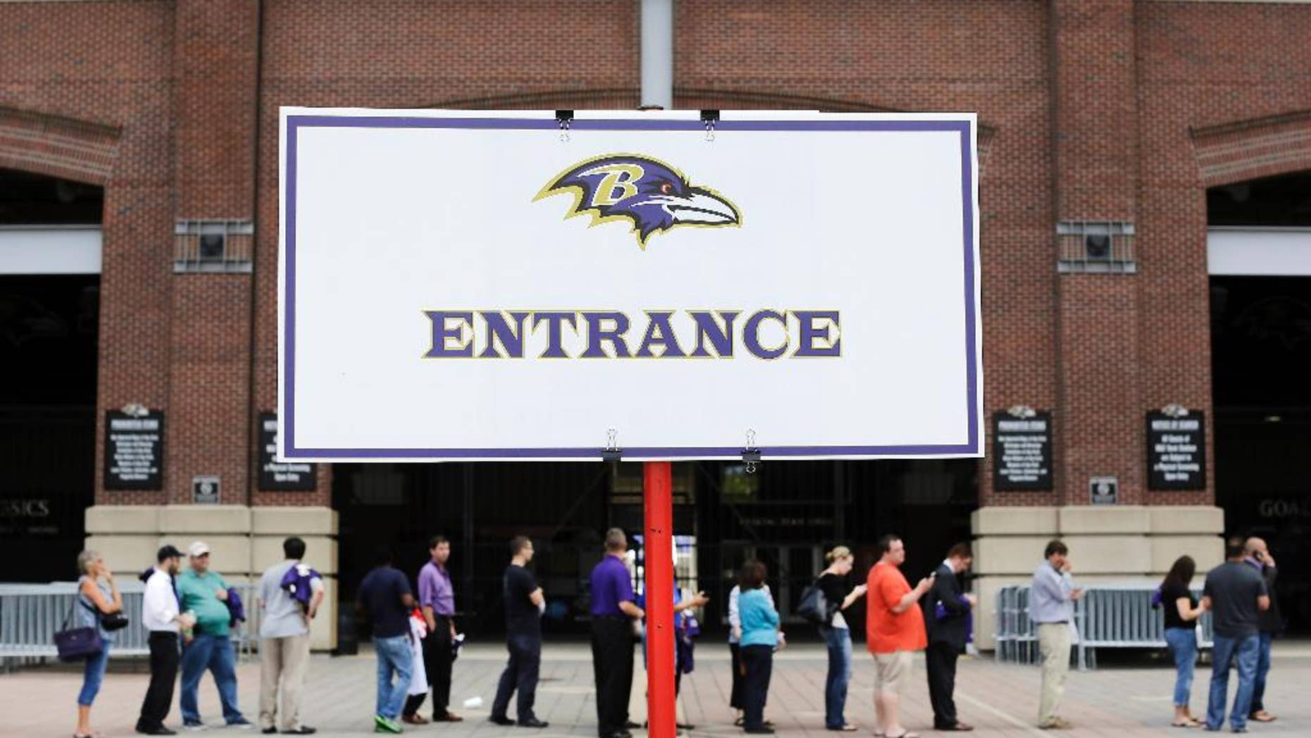 Football fans wait in line to trade in their former Baltimore Ravens running back Ray Rice jerseys, Friday, Sept. 19, 2014, at M&T Bank Stadium in Baltimore. The Ravens offered fans a chance to trade in their Rice jerseys for those of another player after he was cut by the team and suspended indefinitely by the NFL for domestic violence. (AP Photo/Patrick Semansky)