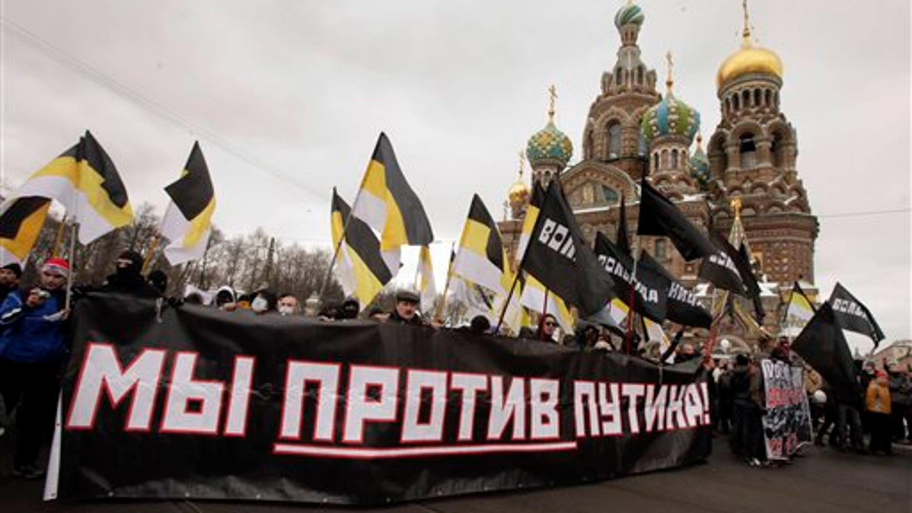 Feb. 25: Protesters attend a massive protest rally against Prime Minister Vladimir Putin's rule in St. Petersburg, Russia, Saturday. The poster reads: 'We against Putin.'