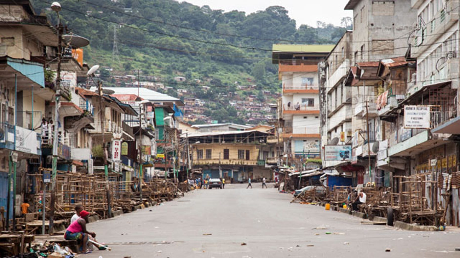 September 21, 2014: A few people are seen during a three-day lockdown to prevent the spread of the Ebola virus, in Freetown, Sierra Leone. (AP Photo/Michael Duff)