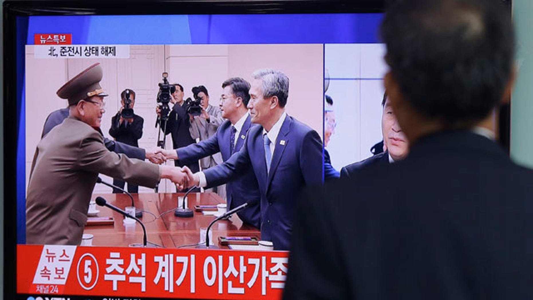 Aug. 25, 2015: A man at the Seoul Railway Station watches a TV news program reporting South Korea and North Korea reached an agreement. After 40-plus-hours of talks, the two Koreas on Tuesday pulled back from the brink with an accord that allows both sides to save face and avert the bloodshed they've been threatening each other with for weeks. (AP Photo/Ahn Young-joon)