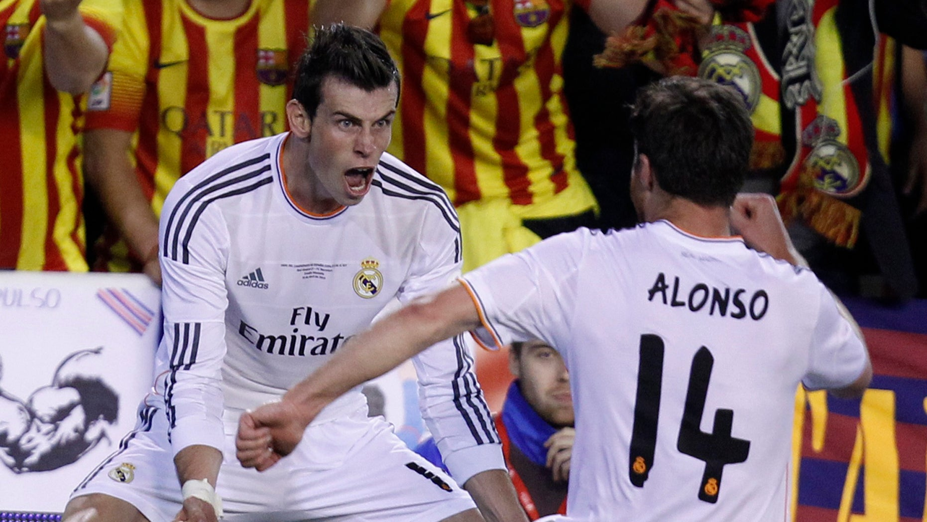 Real's Gareth Bale, left celebrates with Xabi Alonso on Wednesday, April 16, 2014.