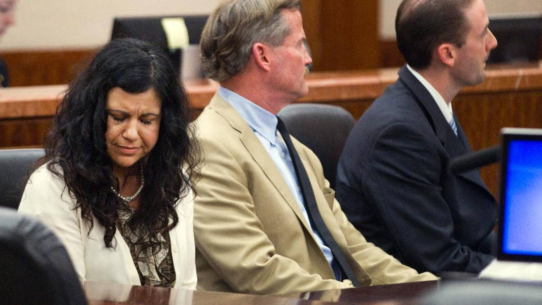 Ana Trujillo reacts after being found guilty of killing her boyfriend, after the jury deliberated less than two hours, on Tuesday, April 8, 2014, in Houston. Trujillo, 45, was found guilty of fatally stabbing her boyfriend with the stiletto heel of her shoe, hitting him at least 25 times in the face. (AP Photo/Houston Chronicle, Brett Coomer)
