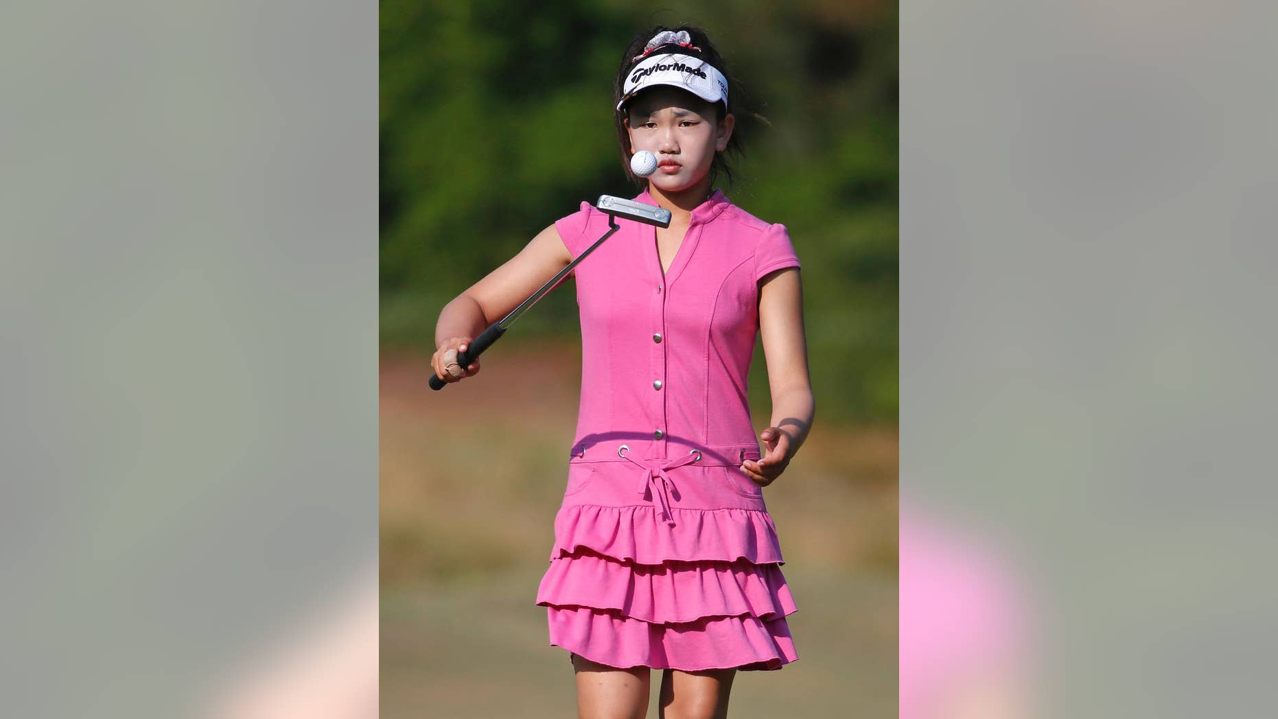 Lucy Li bounces the ball off of her putter on the second green during a practice round for the U.S. Women's Open golf tournament in Pinehurst, N.C., Wednesday, June 18, 2014. The sixth-grader from California is the youngest qualifier in the history of the U.S. Women's Open. (AP Photo/John Bazemore)