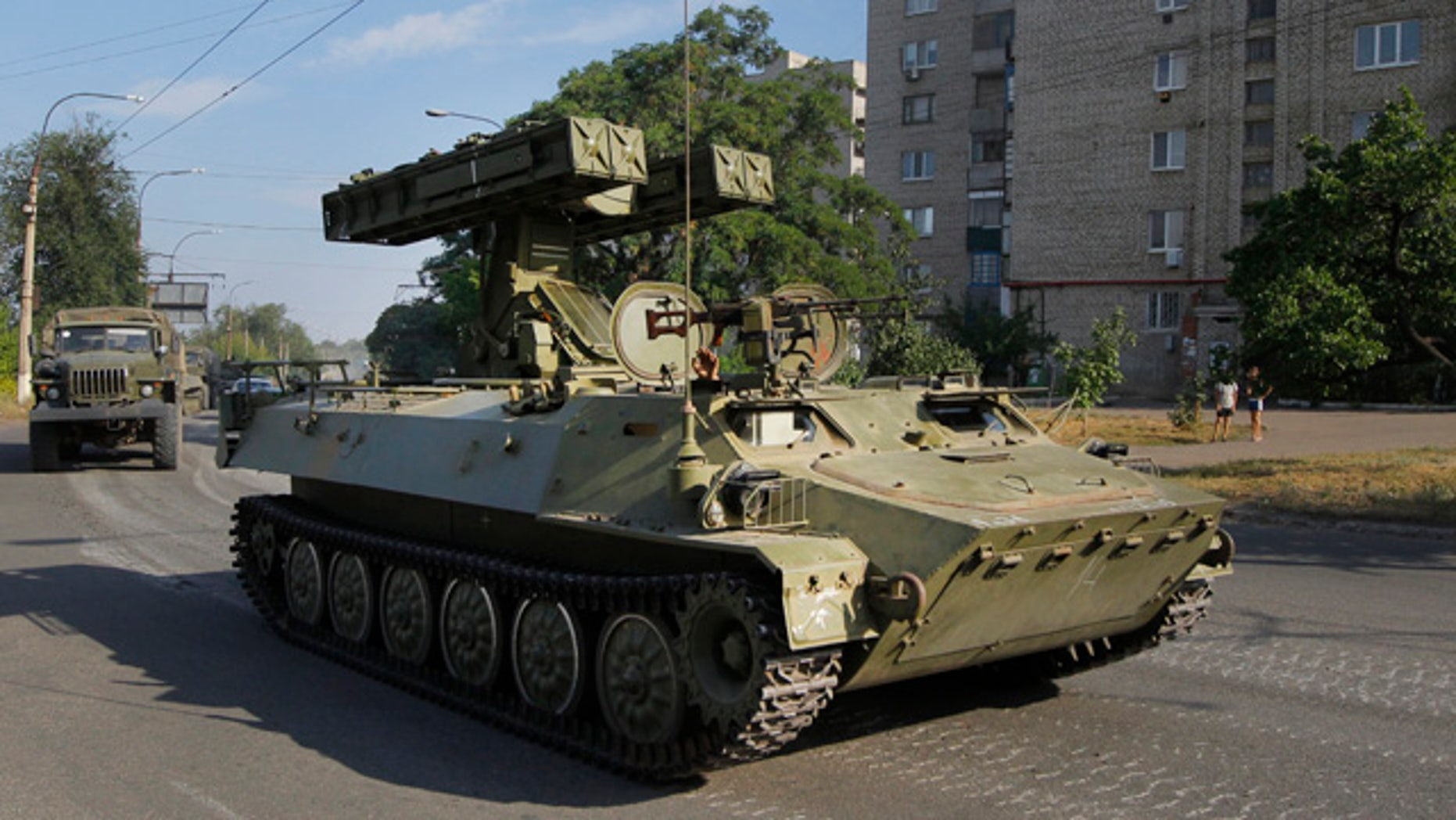 FILE - This is a Sunday, Aug. 17, 2014  file photo of a pro-Russian missile launcher as it drives in the town of Krasnodon. (AP Photo/Sergei Grits, File)