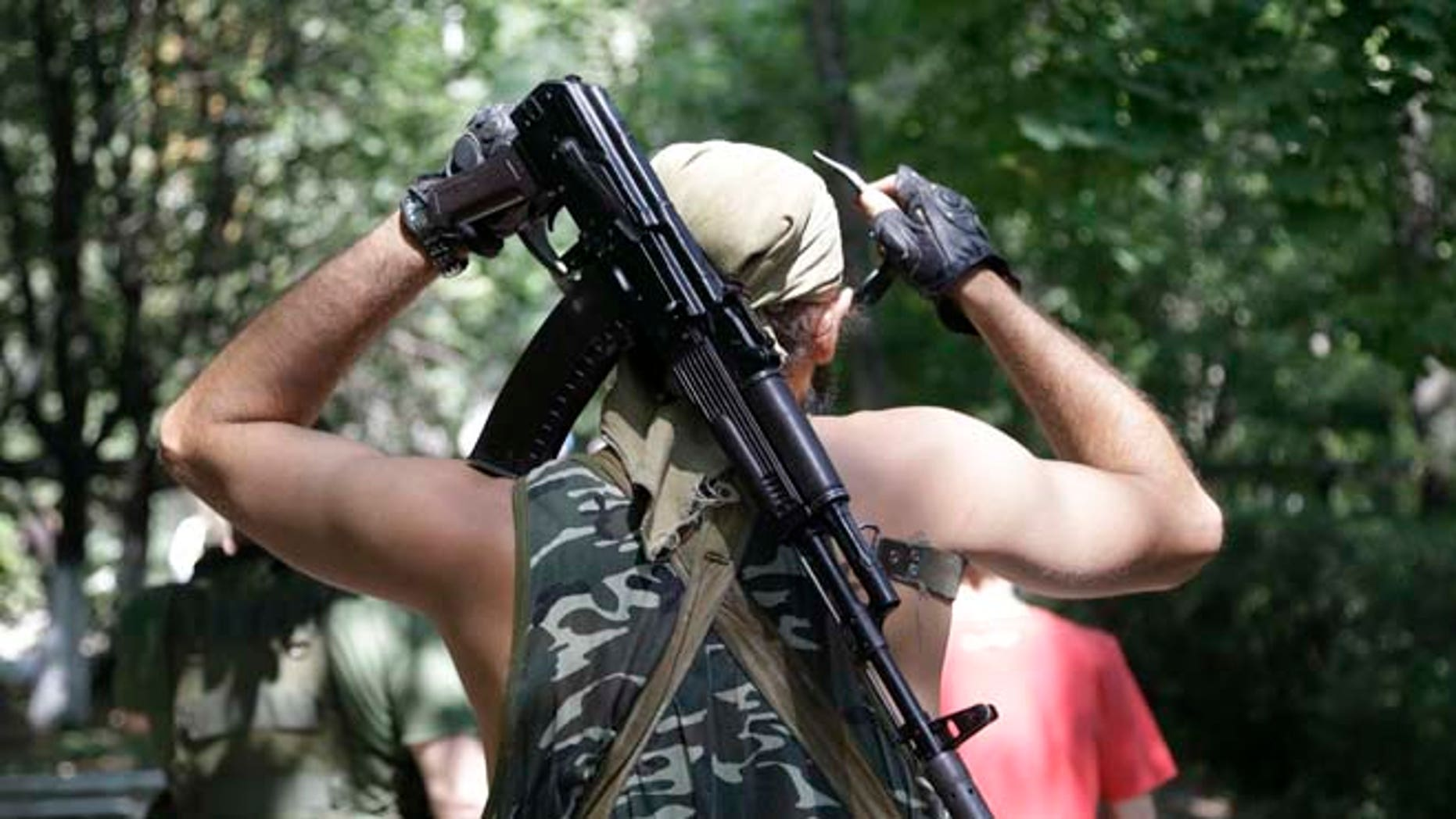 Aug. 6, 2014: A Pro-Russian rebel adjusts his weapon in Donetsk, eastern Ukraine. (AP)
