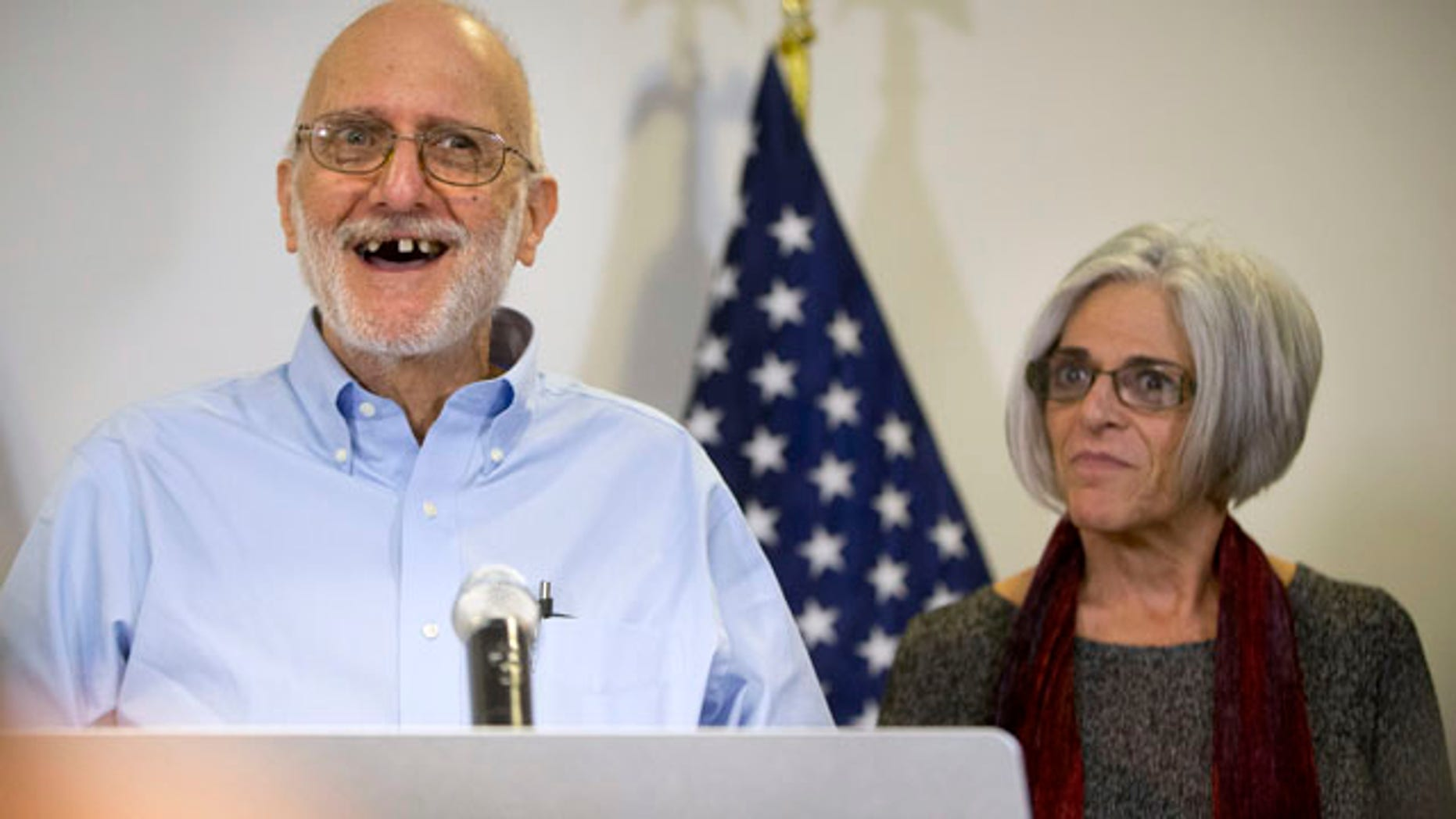 Dec. 17, 2014: Alan Gross, accompanied by his wife, Judy, speaks during a news conference at his lawyer's office in Washington. Gross was released from Cuba after five years in a Cuban prison. (AP Photo/Pablo Martinez Monsivais)