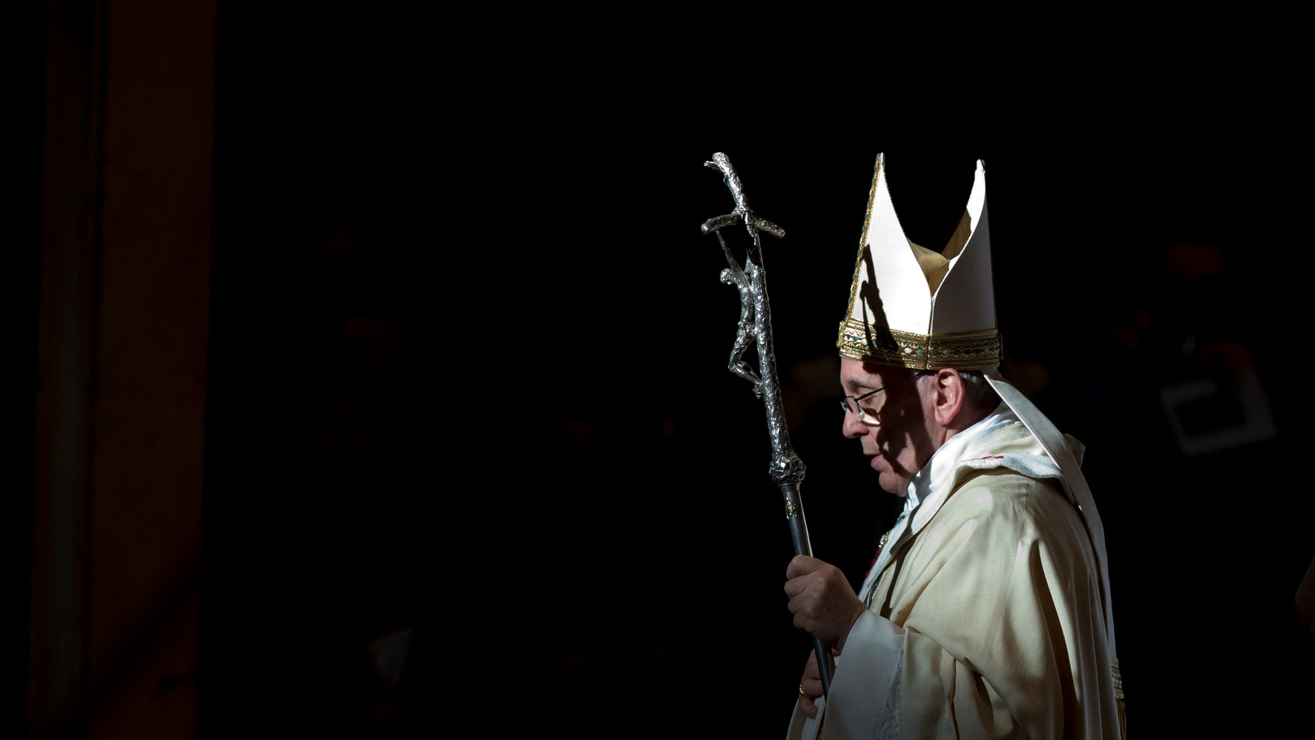 Pope Francis holds the pastoral staff as he leaves after celebrating a Mass in St. Peter's Basilica, at the Vatican, to mark Epiphany, Monday, Jan. 6, 2014. The Epiphany day, is a joyous day for Catholics in which they recall the journey of the Three Kings, or Magi, to pay homage to Baby Jesus. (AP Photo/Andrew Medichini)