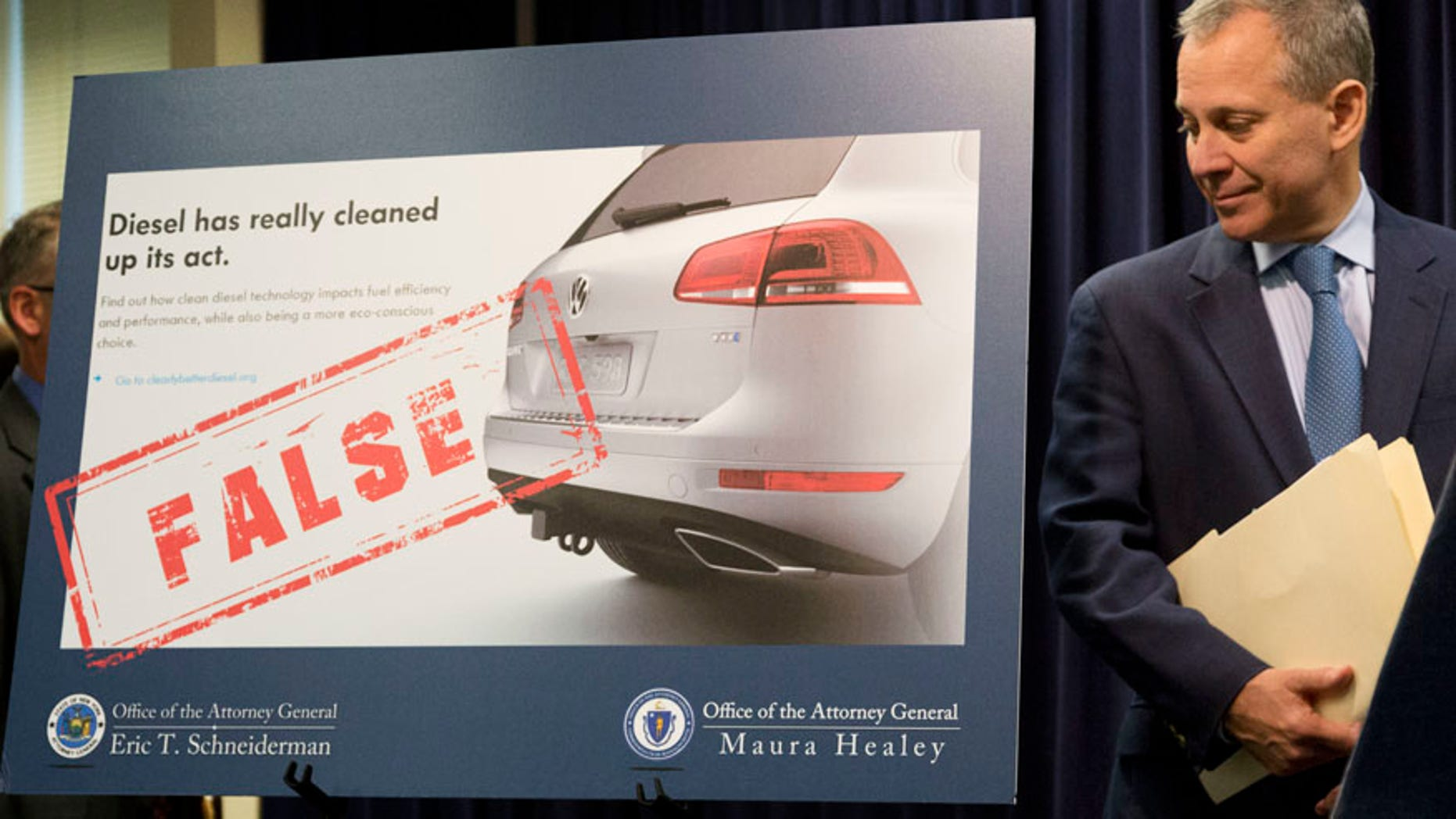 New York Attorney General Eric Schneiderman announces a lawsuit against Volkswagen, Tuesday, July 19, 2016, in New York. (AP Photo/Mark Lennihan)