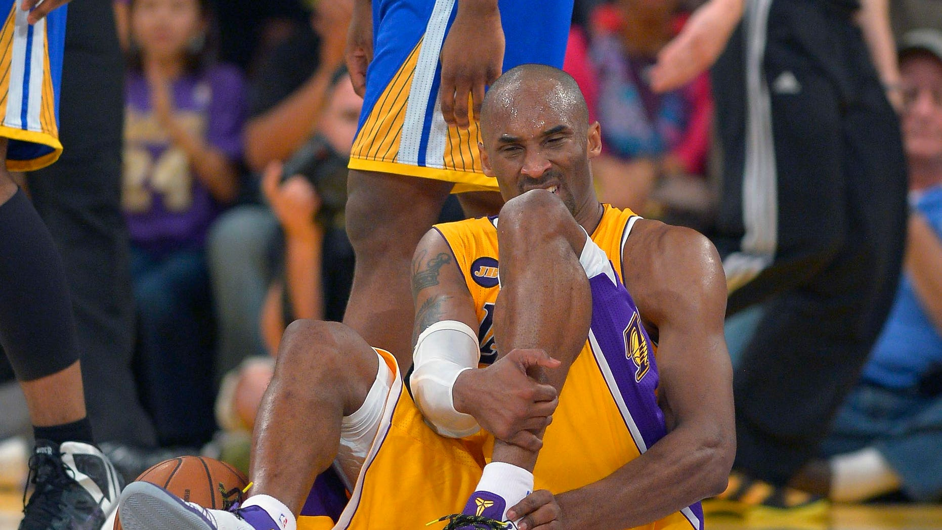 April 12, 2013: Los Angeles Lakers guard Kobe Bryant grimaces after being injured during the second half of their NBA basketball game against the Golden State Warriors in Los Angeles.