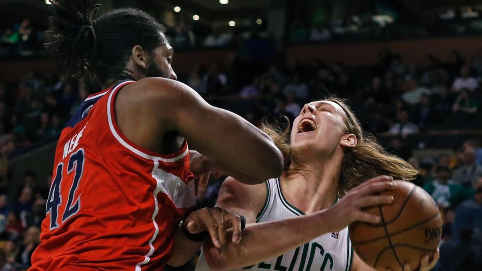 Boston Celtics center Kelly Olynyk (41) goes up to shoot against Washington Wizards forward Nene Hilario (42) during the second half of an NBA basketball game in Boston, Wednesday, April 16, 2014. The Wizards won 118-102. (AP Photo/Elise Amendola)