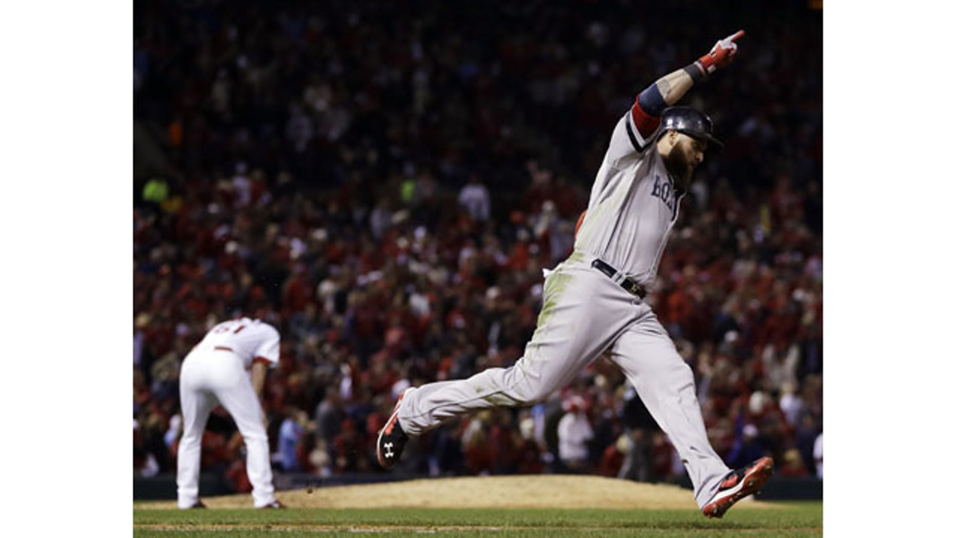 Boston Red Sox's Jonny Gomes celebrates his three-run home run off St. Louis Cardinals relief pitcher Seth Maness, left, during the sixth inning of Game 4 of baseball's World Series Sunday, Oct. 27, 2013, in St. Louis. (AP Photo/Jeff Roberson)