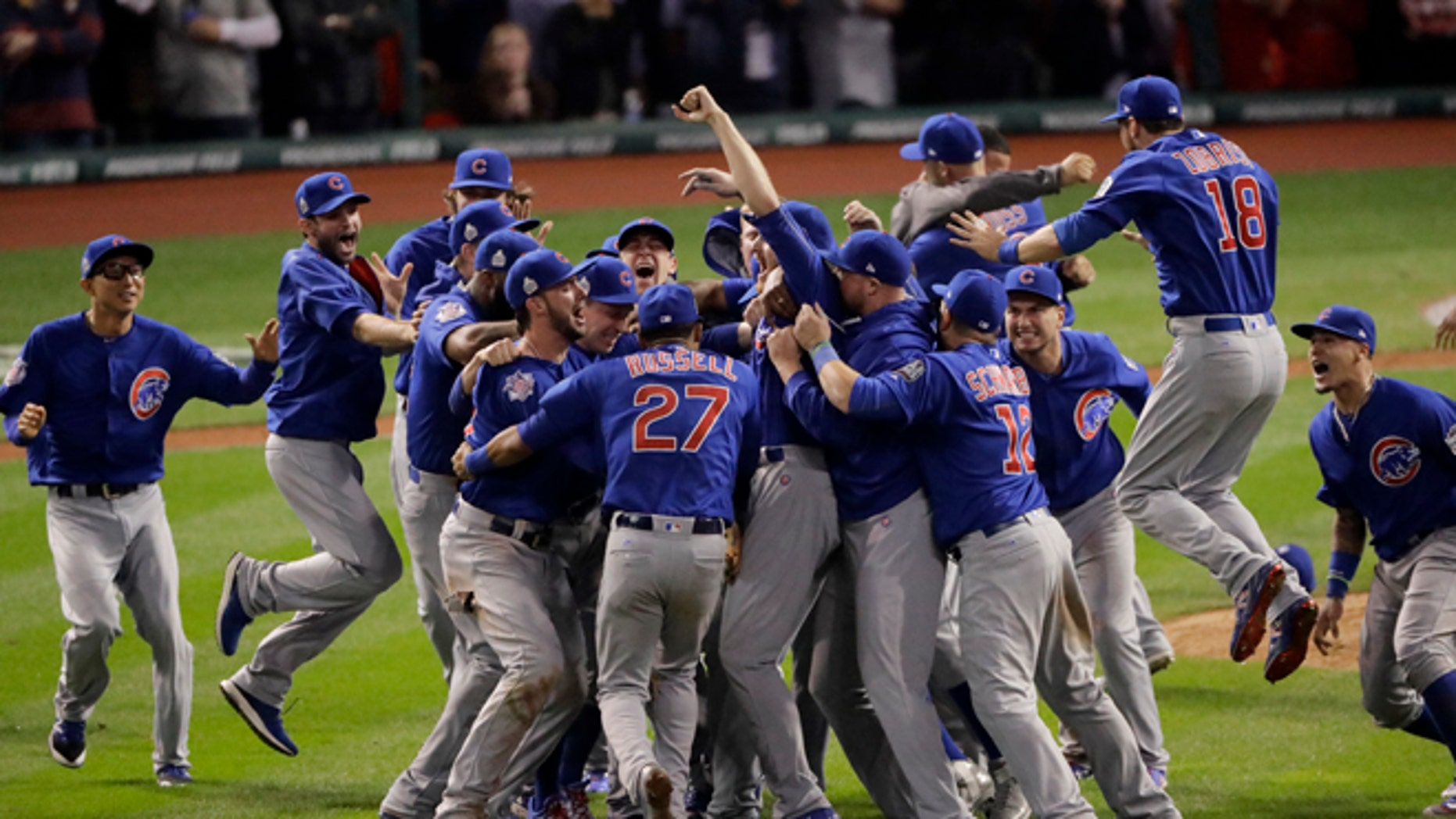 Chicago Cubs celebrate after Game 7 of the Major League Baseball World Series against the Cleveland Indians Thursday, Nov. 3, 2016, in Cleveland. The Cubs won 8-7 in 10 innings to win the series 4-3. (AP Photo/Charlie Riedel)
