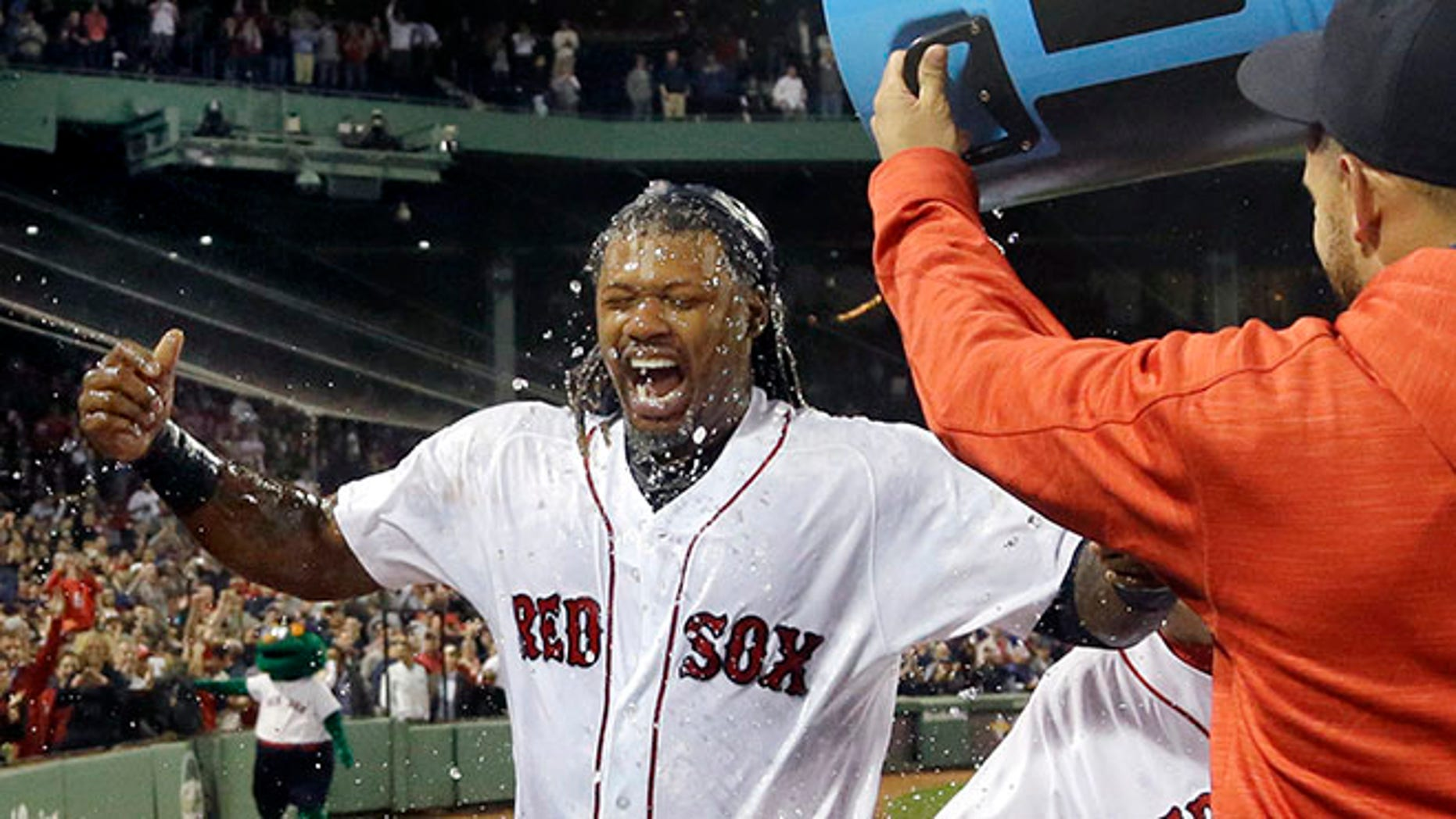 Boston Red Sox's Hanley Ramirez is doused by teammates on Thursday, Sept. 15, 2016, in Boston.