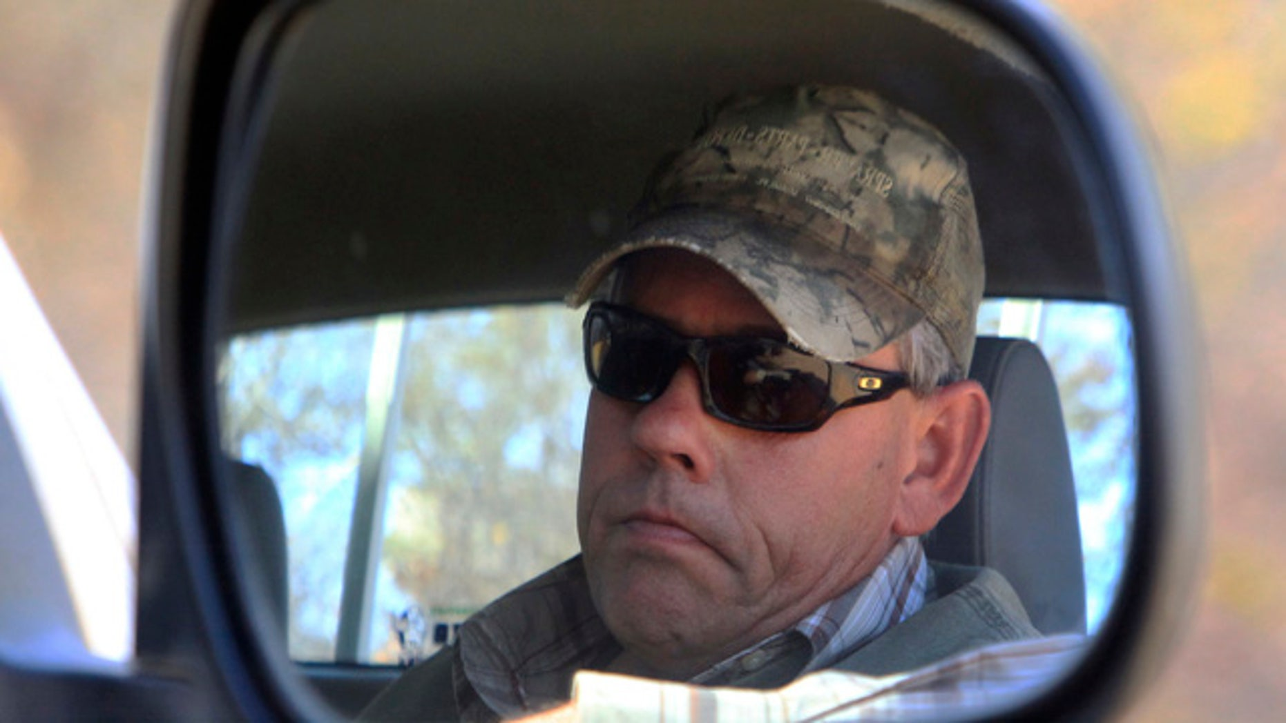 Aug. 5, 2015: Professional hunter Theodore Bronkhorst sits in his car upon his arrival at the magistrates courts to face trial in Hwange about 435 miles south west of Harare, Zimbabwe. (AP Photo/Tsvangirayi Mukwazhi)