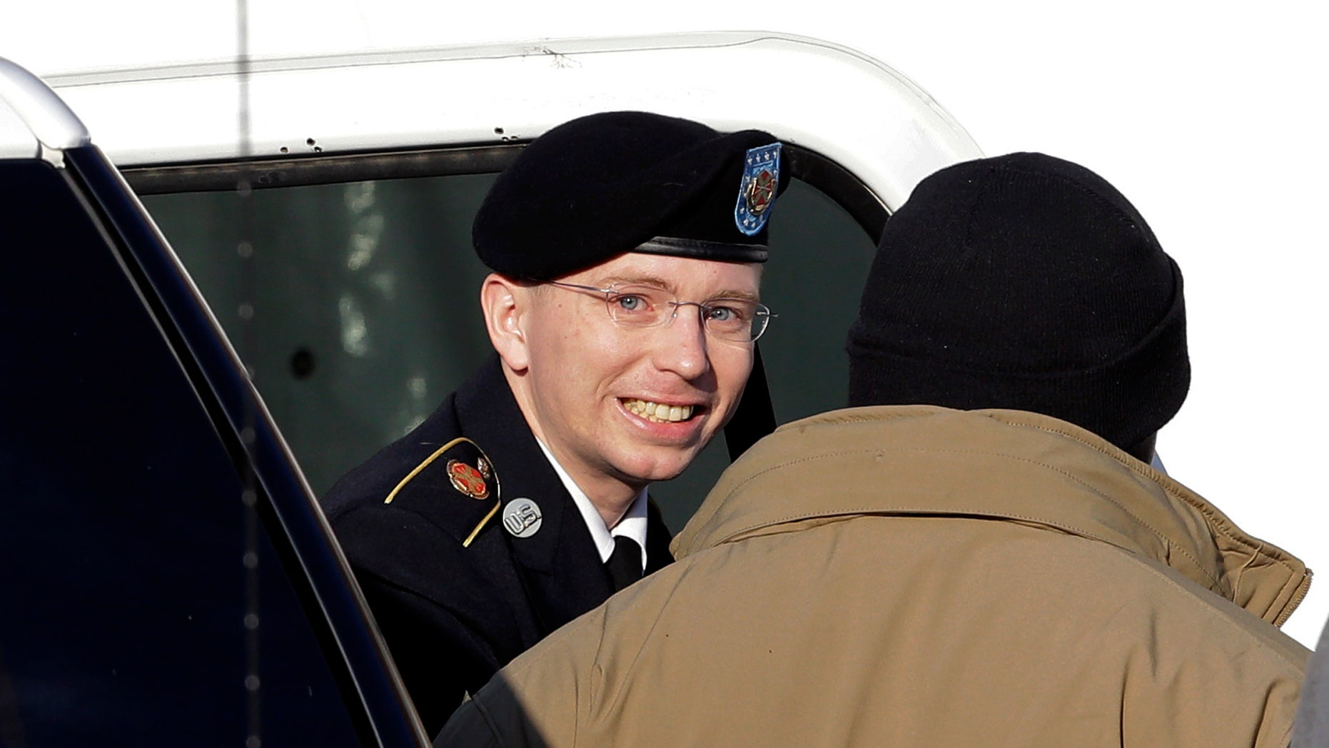 Nov. 28, 2012: Army Pfc. Bradley Manning, center, steps out of a security vehicle as he is escorted into a courthouse in Fort Meade, Md.,  for a pretrial hearing.