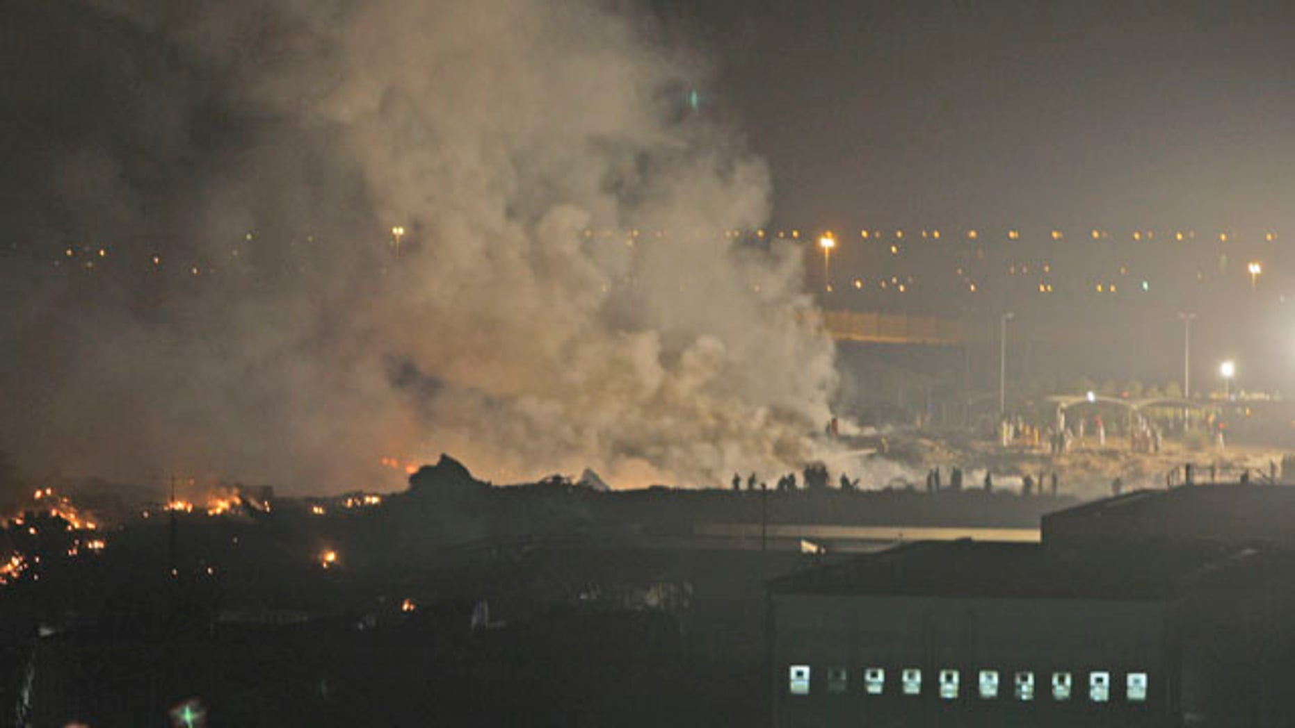 Sept. 3: Smoke rises from the site of a cargo plane crash in Dubai, United Arab Emirates. Officials say a UPS cargo plane with two crew members on board has crashed shortly after takeoff outside Dubai.