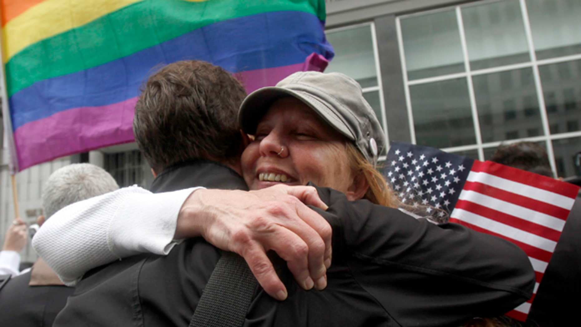 Aug. 4, 2010: Sheree Red Bornand, right, hugs Aidan Dunn after hearing the decision in the United States District Court proceedings challenging Proposition 8 outside of the Phillip Burton Federal Building in San Francisco.