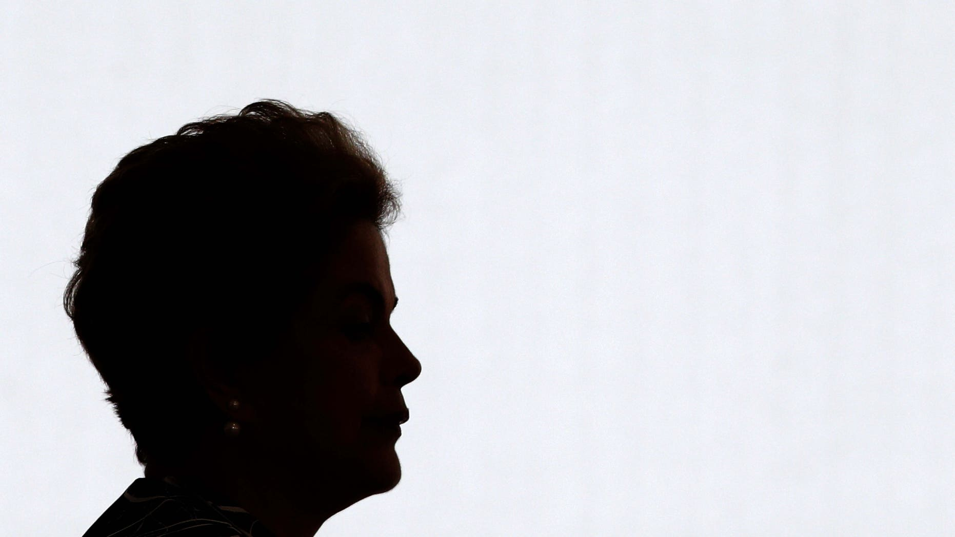 """Brazil's President Dilma Rousseff arrives for a ceremony to announce an addition to the government subsidized housing program coined """"My home, My life, at Planalto presidential palace in Brasilia, Brazil, Friday, May 6, 2016. Brazil's Senate impeachment commission has started deliberations over whether to recommend Rousseff's suspension to the full house. A Friday vote by a simple majority will send the case to all senators for a final decision Wednesday. (AP Photo/Eraldo Peres)"""
