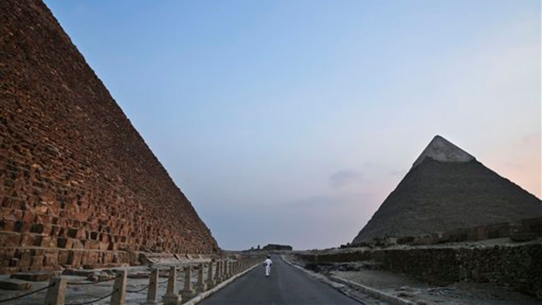 Gunmen on a motorcycle opened fire on a church near the Giza pyramids, state media report.