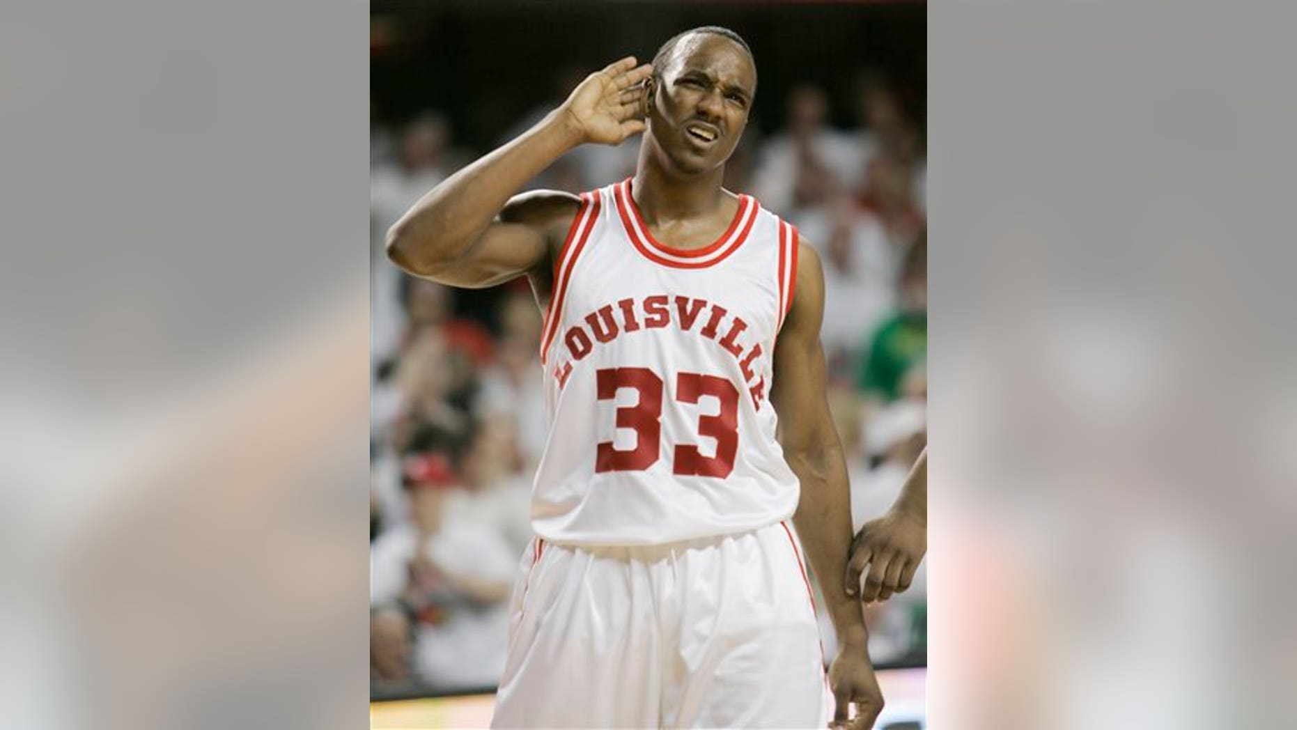 2009 file photo of Andre McGee, who played for Louisville before becoming a staffer. (AP Photo/Ed Reinke)