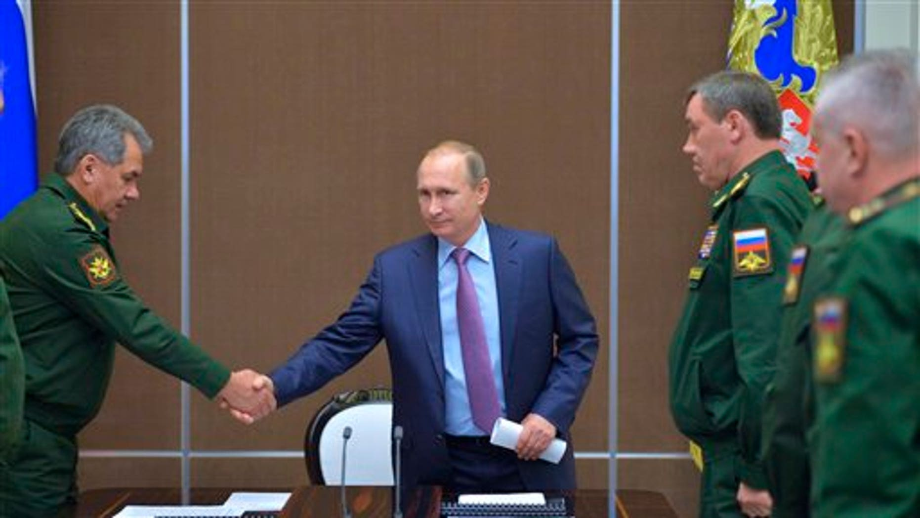 Russian President Vladimir Putin at a meeting with defense officials Tuesday.
