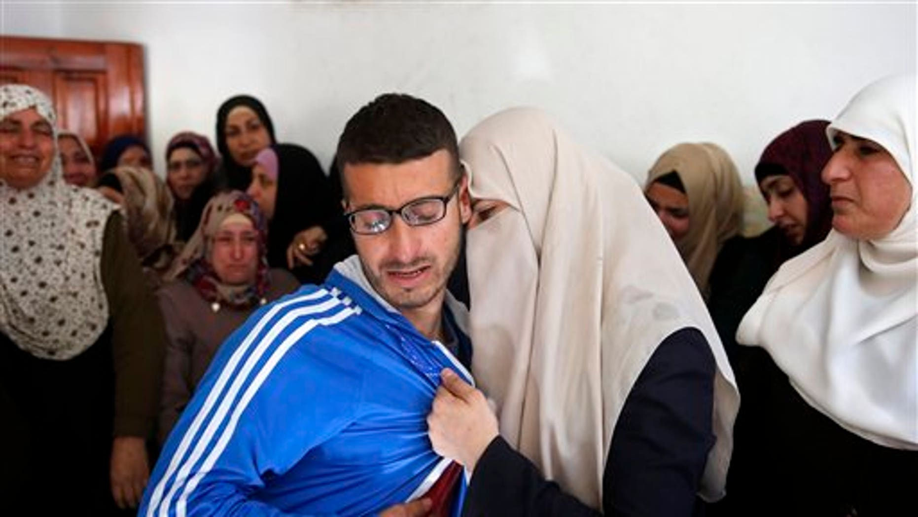 Palestinians mourn for 27-year-old Abdallah Shalaldeh. Israeli forces disguised in traditional Arab outfits burst into a hospital overnight Thursday, killing Shalaldeh, according to officials there.