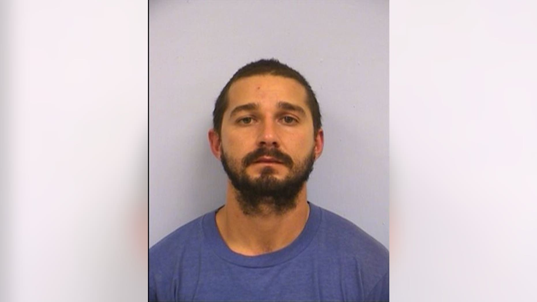 This booking mug provided by the Austin Police Department shows actor Shia LaBeouf. (Austin Police Department via AP)