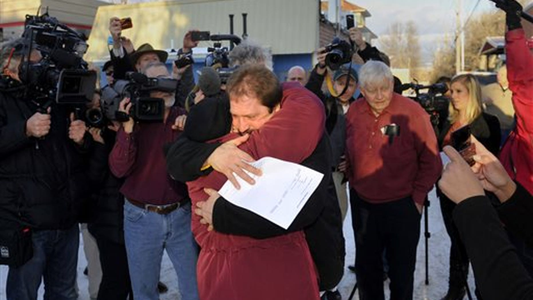 Barry Beach hugs his mother after being released in 2011, before he was sent back to prison.