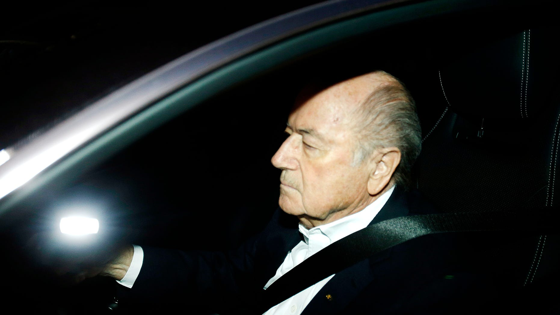 FILE - In this Sept. 29, 2015 file photo FIFA President Sepp Blatter drives his car into the garage of the FIFA headquarters on his way to work in Zurich, Switzerland (AP Photo/Michael Probst, file)