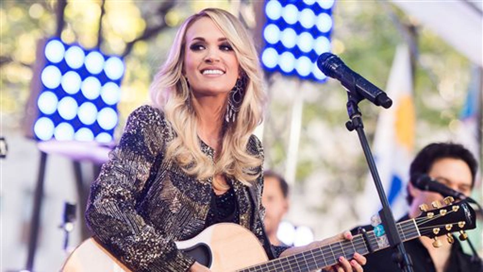 Carrie Underwood performs Friday in New York. (Photo by Charles Sykes/Invision/AP)
