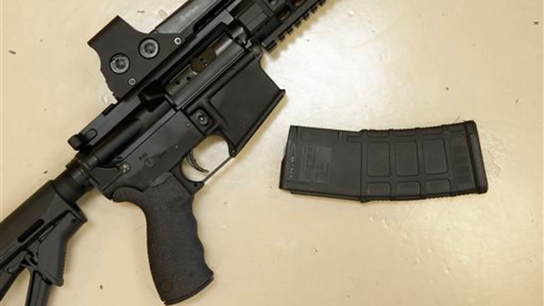In this file photo, a custom-made semi-automatic hunting rifle with a high-capacity detachable magazine is displayed at TDS Guns in Rocklin, Calif. Calif. (AP Photo/Rich Pedroncelli)