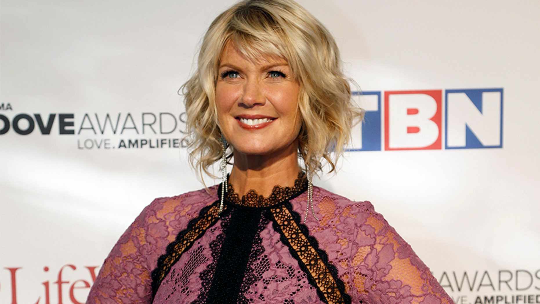FILE - In this Oct. 11, 2016 file photo, Natalie Grant appears at the 47th Annual GMA Dove Awards in Nashville, Tenn. Grant will undergo thyroid surgery to remove tumors and will cancel shows between mid-October and November to recover. Grant posted a video message on Facebook on Thursday, Sept. 21, 2017, explaining that doctors had been monitoring several tumors or nodules on her thyroid for years. She asked for prayers and said she has complete faith in God.  (Photo by Donn Jones/Invision/AP, File)