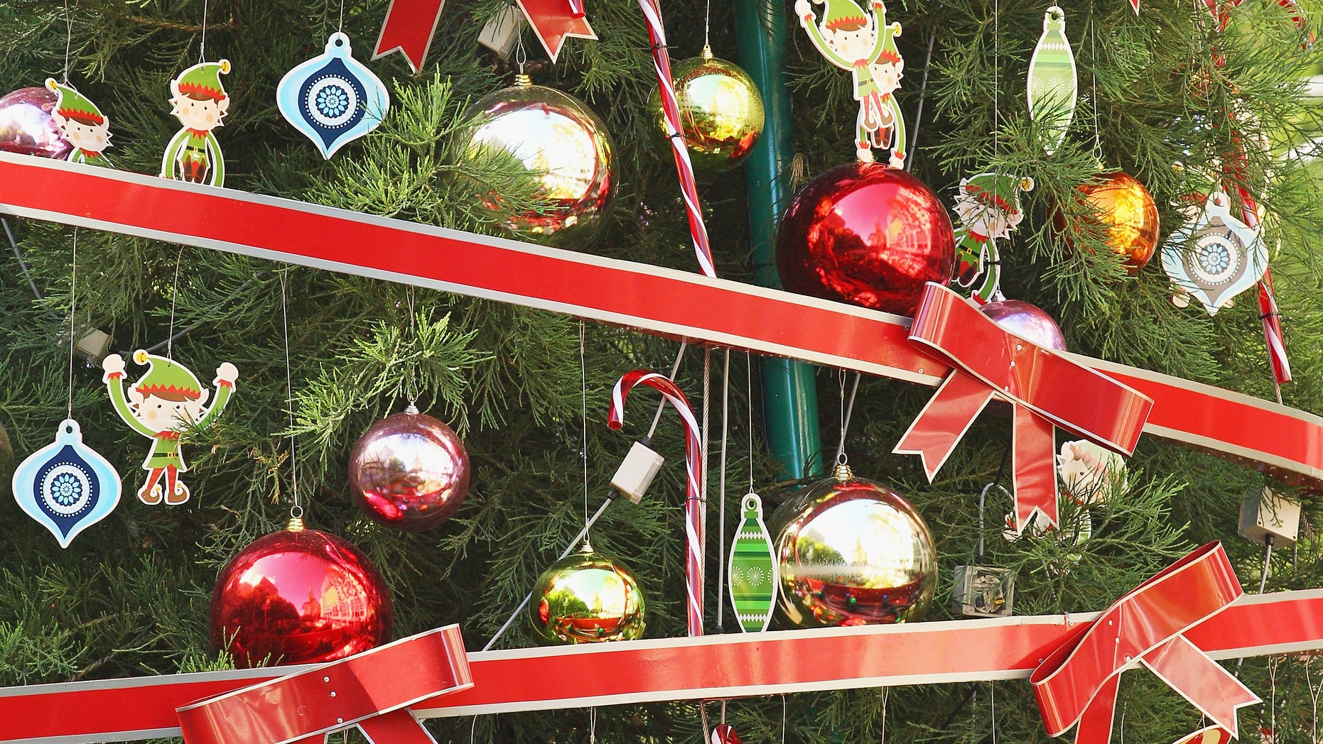 MELBOURNE, AUSTRALIA - DECEMBER 20:  Decorations adorn a large Christmas tree in Christmas Square on December 20, 2012 in Melbourne, Australia. Australian retailers are looking forward to an improved Christmas trading period when compared to recent years. Improved consumer confidence, interest rate cuts, and stabilising house prices point to a positive outlook for the current Christmas period.  (Photo by Scott Barbour/Getty Images)