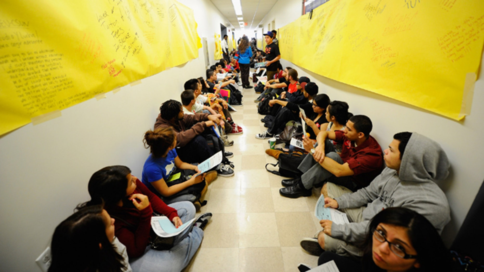LOS ANGELES, CA - APRIL 13:  Students and faculty members stage a sit-in in front of the school president's office at California State University, Northridge, demonstrating against proposed budget cuts at all 23 Cal State University campuses statewide on April 13, 2011 in Los Angeles, California. Teachers and students were protesting a plan to slash the Cal State budget to save money by cutting enrollment at Cal State campuses by 10,000 students, and cut $11 million from the chancellor's office and shrink campus funding by $300 million.  (Photo by Kevork Djansezian/Getty Images)