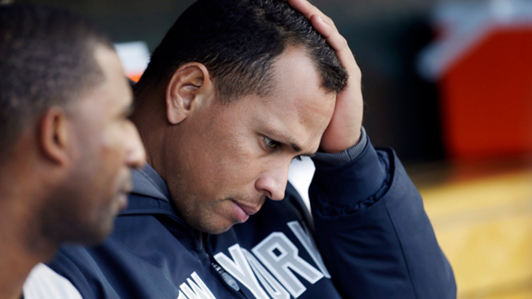 New York Yankees' Alex Rodriguez watches from the bench during Game 4 of the American League championship series against the Detroit Tigers Thursday, Oct. 18, 2012, in Detroit. (AP Photo/Paul Sancya )