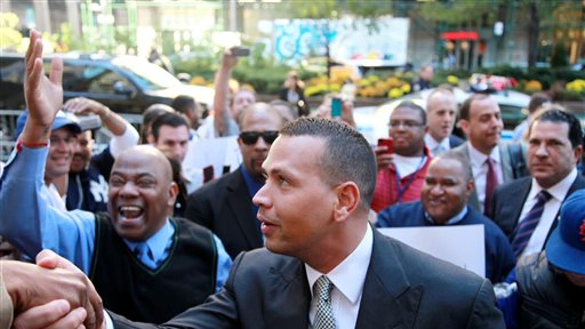 FILE - In this Oct. 1, 2013, file photo, New York Yankees' Alex Rodriguez arrives at the offices of Major League Baseball in New York. Rodriguez's 211-game suspension was the longest of the 13 announced in August for players connected to a Florida anti-aging clinic accused of distributing banned PEDs. The Yankees' slugger was the only one to contest the penalty, and the year ends with an arbitrator yet to rule. (AP Photo/David Karp, File)