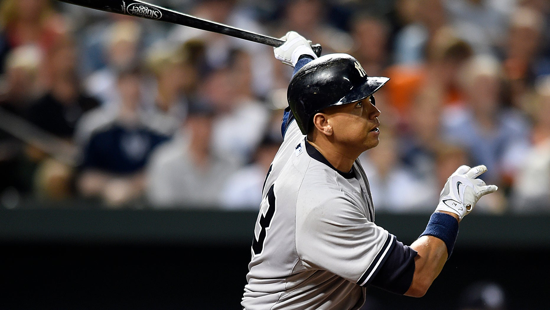 New York Yankees' Alex Rodriguez follows through on a two-run home run against the Baltimore Orioles during the sixth inning of a baseball game Saturday, June 13, 2015, in Baltimore. (AP Photo/Gail Burton)